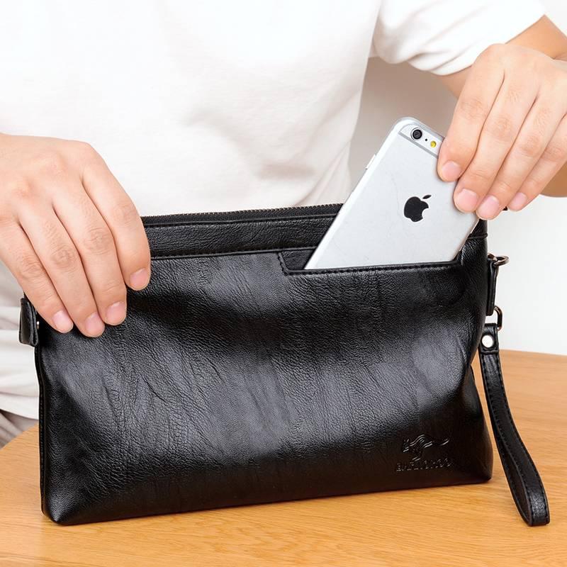 正品男士手包韩版手机信封包软牛皮大容量休闲手拿抓包男夹包商务