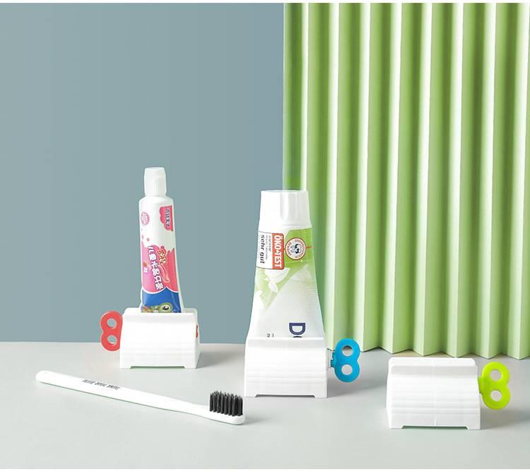 日式手动牙膏挤压器家居挤牙膏夹座式肥皂盒洗面奶挤压器
